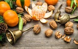 Mandarin oranges, walnuts and christmas tree branches Stock Photo