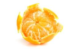 Mandarin with peel off. Isolated on white background Royalty Free Stock Image