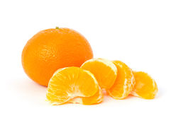 Mandarin with peeled pieces Royalty Free Stock Images