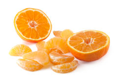 Mandarin and peeled slices Stock Photography