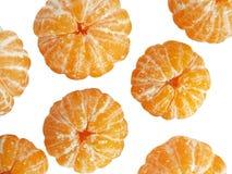 Mandarin peeled. Some mandarins purified and isolated on white background Royalty Free Stock Photos