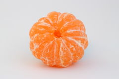 Mandarin. Peeled mandarin on a white Stock Image