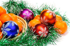 Mandarin,pine branches and christmas balls Stock Photos