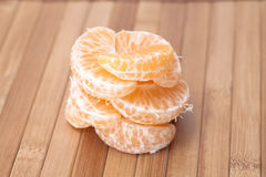 Mandarin roll. On wooden table Royalty Free Stock Images