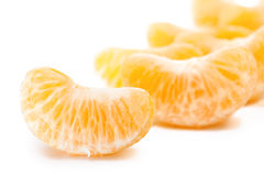 Mandarin segments. Orange fruit. Mandarin section segment on white background Stock Photography