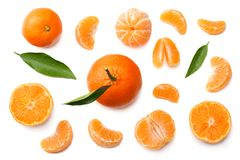 Mandarin with slices and green leaf isolated on white background top view royalty free stock photos