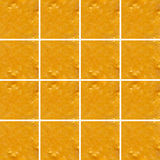 Mandarin smoothie texture inside square shapes Royalty Free Stock Photos