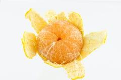 Mandarin som skalas i halva Royaltyfria Foton