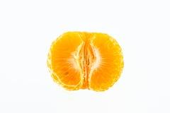 Mandarin som skalas i halva Arkivbilder