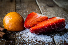 Mandarin, strawberry on an old wooden table in an Royalty Free Stock Photography