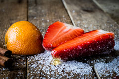 Mandarin, strawberry on an old wooden table in an Royalty Free Stock Photos