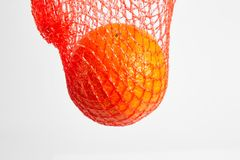 Mandarin, tangerine citrus fruit in red net stock photo