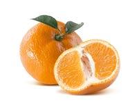 Mandarin tangerine and cut half on white background. Mandarin tangerine with leaf and cut half on white background as package design element stock photography