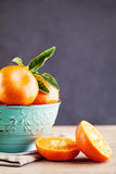 Mandarin or Tangerine Fruits in Blue Bowl. On Blackboard Background Royalty Free Stock Image
