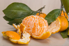 Mandarin or tangerine with leaves and branches on a marble table Stock Photos