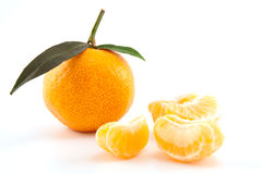 Mandarin or tangerine with leaves and peeled one Stock Image