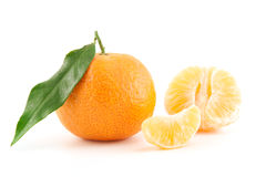 Mandarin or tangerine with leaves and peeled one Stock Photography