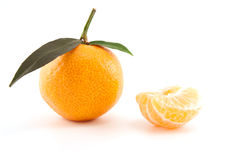 Mandarin or tangerine with leaves and peeled one Royalty Free Stock Photo