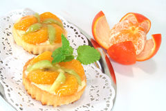 Mandarin tartlet with lemon balm Royalty Free Stock Images