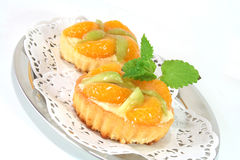 Mandarin tartlet with lemon balm Royalty Free Stock Photography