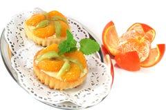 Mandarin tartlet with lemon balm Stock Image