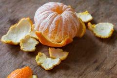 Mandarin utan en peel Arkivfoton