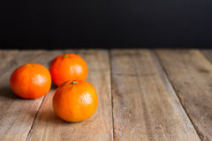 Mandarin on wood Royalty Free Stock Images