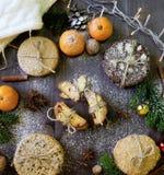 Mandarina, galletas y molletes Foto de archivo libre de regalías