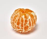 Mandarina madura en un fondo blanco Fotografía macra fotografía de archivo libre de regalías