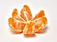 Mandarina madura en un fondo blanco Fotografía macra foto de archivo libre de regalías