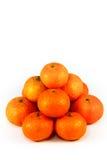 Mandarinas maduras en el fondo blanco Foto de archivo libre de regalías