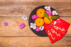 Mandarinas y Año Nuevo lunar con el texto Imagen de archivo
