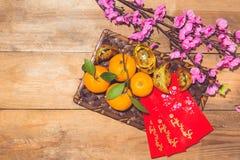 Mandarinas y Año Nuevo lunar con el texto Fotografía de archivo