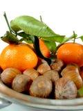 Mandarinas y nueces Foto de archivo