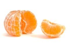 Mandarine. Peeled mandarine on a white background stock images