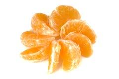 Mandarine. Peeled mandarine on a white background royalty free stock photo