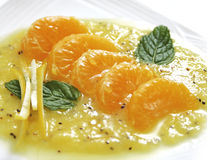 Mandarine avec le kiwi Photographie stock libre de droits