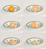 Mandarine being eaten. Time lapse sequence of a mandarine fruit being peeled and eaten Royalty Free Stock Images