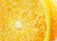 Mandarine coverd with bubbles Royalty Free Stock Photography