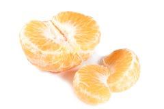 Mandarine et deux parts Image stock
