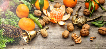 Mandarine fruits and walnuts with christmas decorations Royalty Free Stock Images