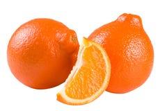 Mandarine ou Mineola de deux oranges avec la tranche d'isolement sur le fond blanc Images stock