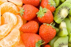 Mandarine, strawberry and kiwi Stock Image