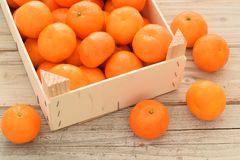 Mandarine or tangerine whole in wooden box. Is on the table stock photos
