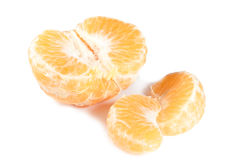 Mandarine und zwei Scheiben Stockbild