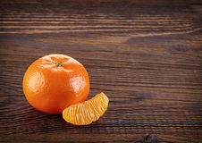 Mandarine on wooden table, pealed Royalty Free Stock Photography