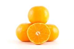 Mandarinen oder Tangerinen und eine Scheibe Lizenzfreie Stockfotos