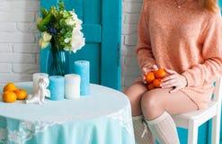 Mandariner på varven av en flicka Royaltyfri Foto
