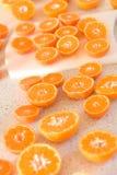 Mandarines coupées en tranches Images libres de droits