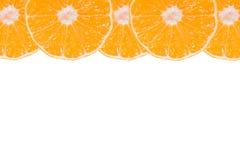 Mandarines enteros y cortados determinados Fotografía de archivo libre de regalías